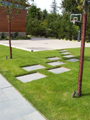Pennsylvania Bluestone is used throughout this site in various forms.  Here it is blended into the lawn as stepping stones provide an access path from parking to the entry