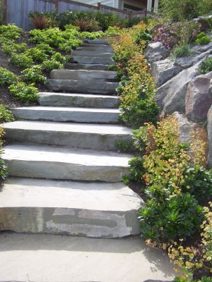 Stone slabs used as stair treads blend seamlessly into both the hillside and natural surroundings