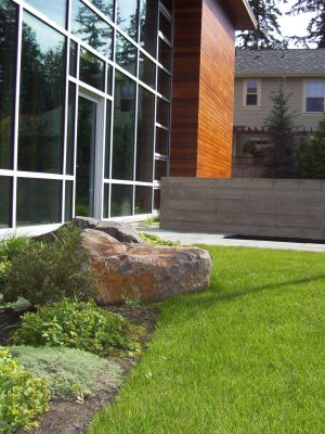 The hard edges of the building are softened by meandering low and varied plantings