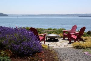 The flagstone patio provides an intimate place to take in the vast views of Puget Sound