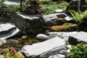 The sittable boulders along the naturalistic water feature provide inviting impromptu seating