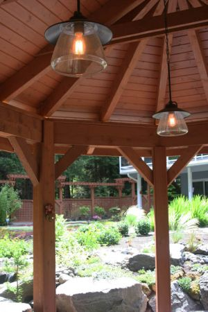The simple craftsman style pavilion provides covered gathering space year round